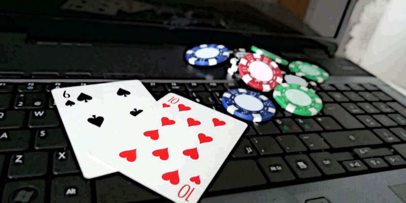 Online Casino Laptop with poker cards and poker chips